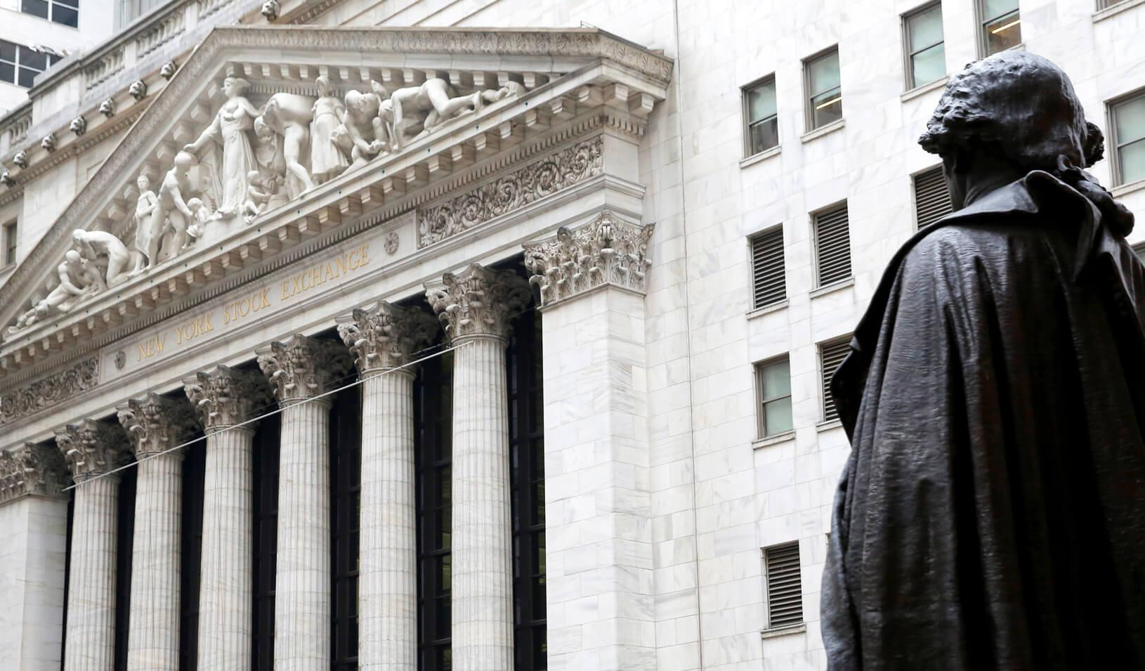 A statue of George Washington stands across from the New York Stock Exchange in Manhattan, New York City. Credit: REUTERS/Andrew Kelly