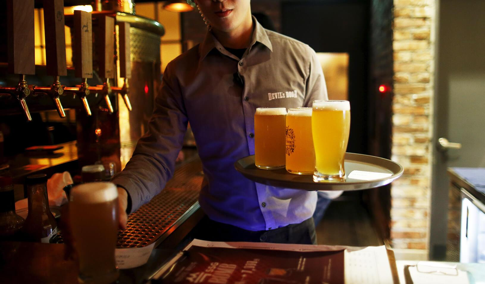 man serving craft beer