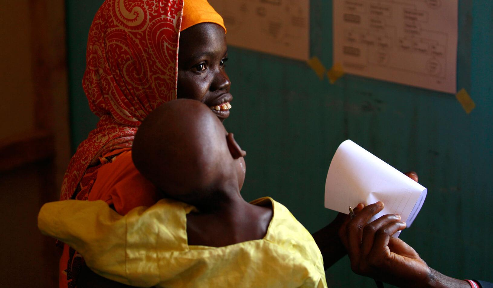 A woman waits with her child in clinic operated by Doctors without Borders in Zamfara | Reuters/Akintunde Akinleye