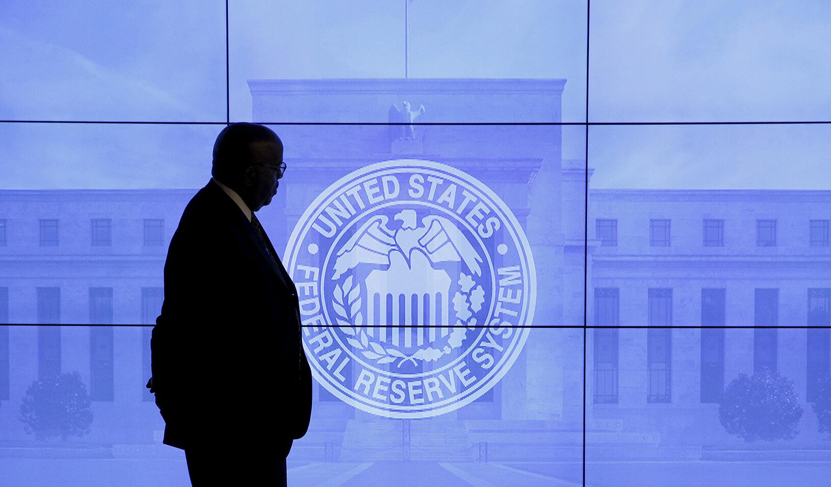 A man overlooks an emblem for the U.S. Federal Reserve System