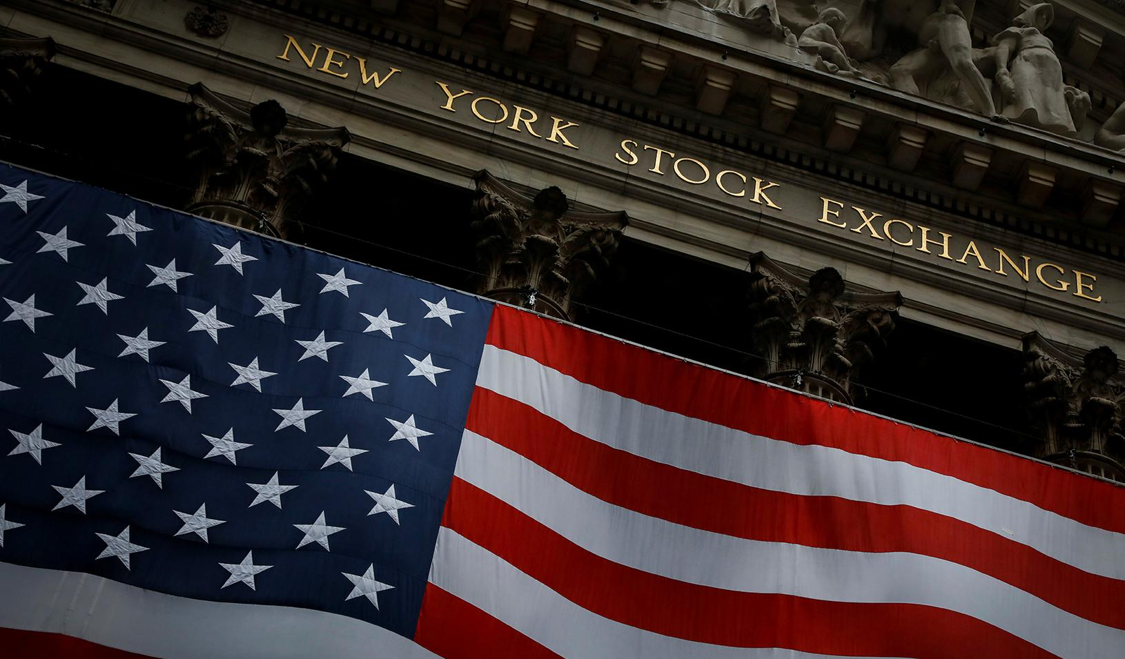 The New York Stock Exchange (NYSE) is seen in the financial district of lower Manhattan during the outbreak of the coronavirus disease in New York City. Credit: Reuters/Andrew Kelly