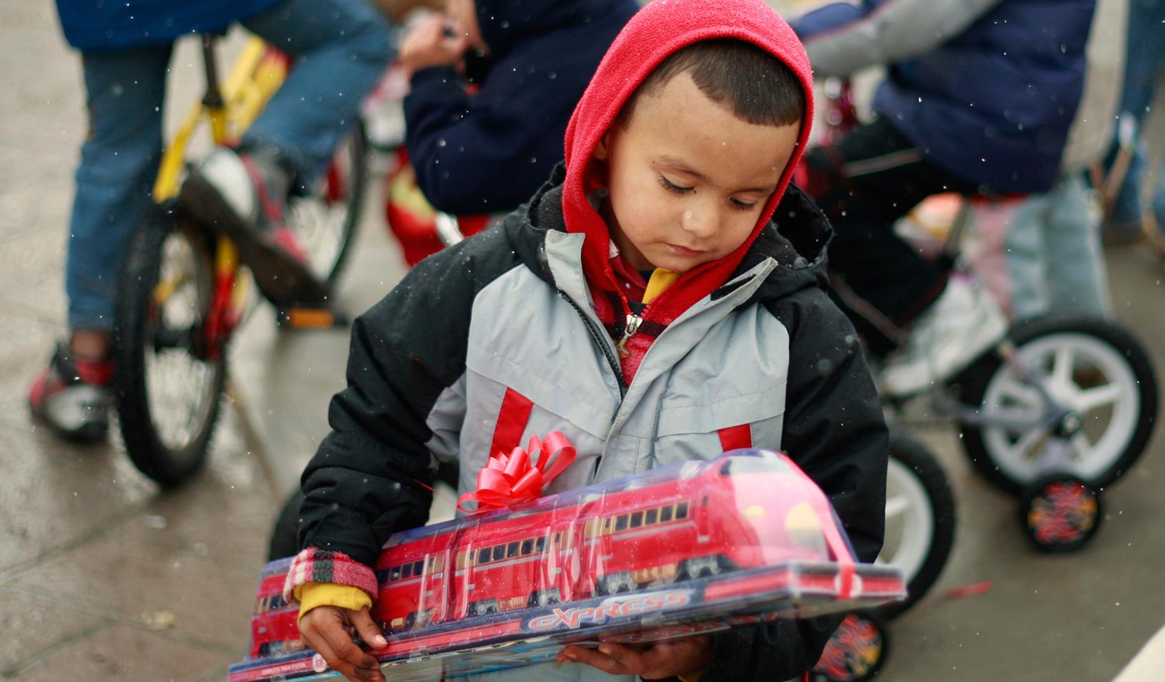 research can money buy happiness stanford graduate school of  a boy holding a toy train