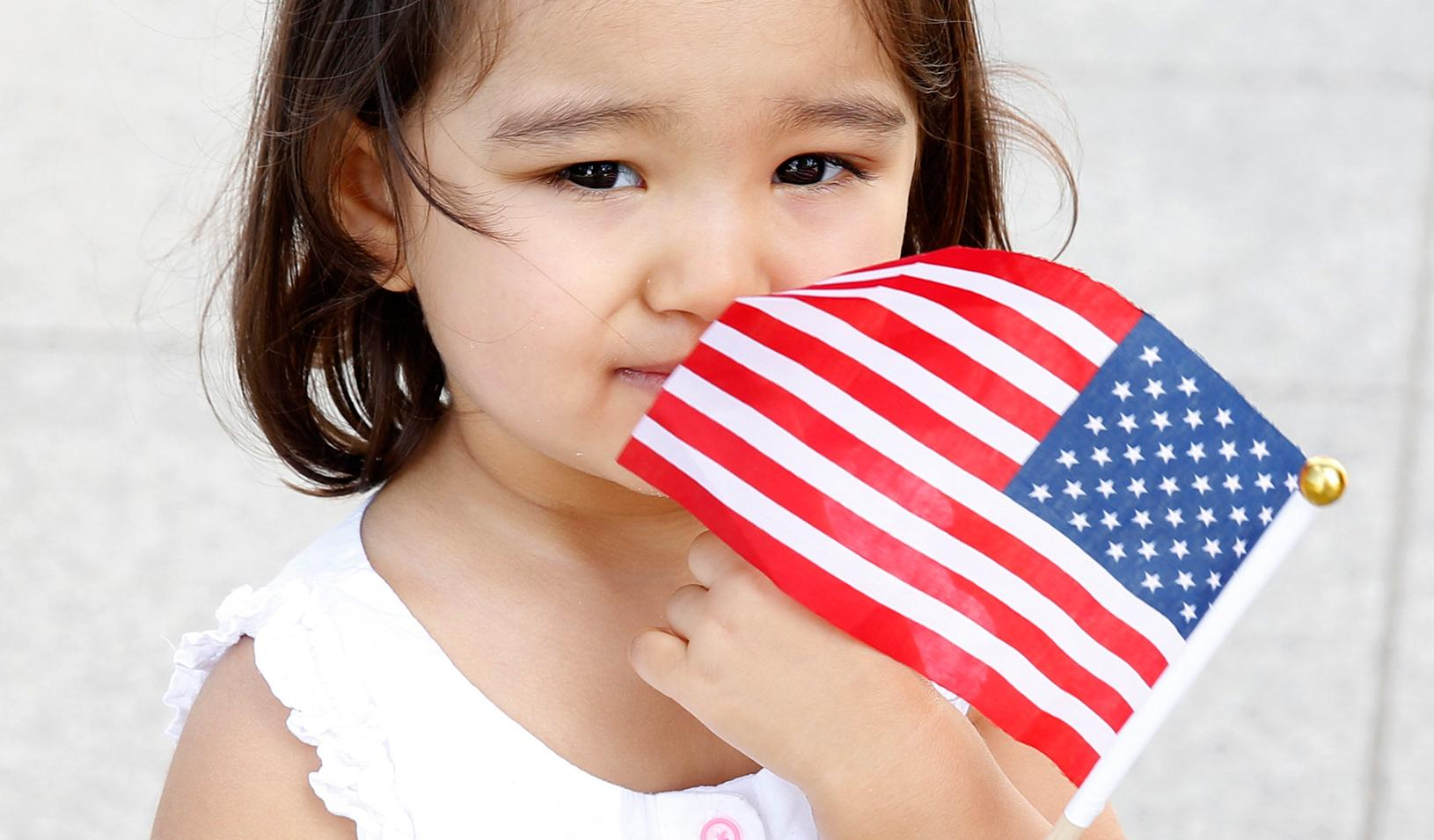 Little girl holding an American flag