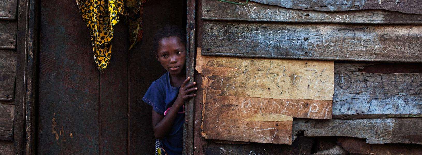 A child standing in a doorway