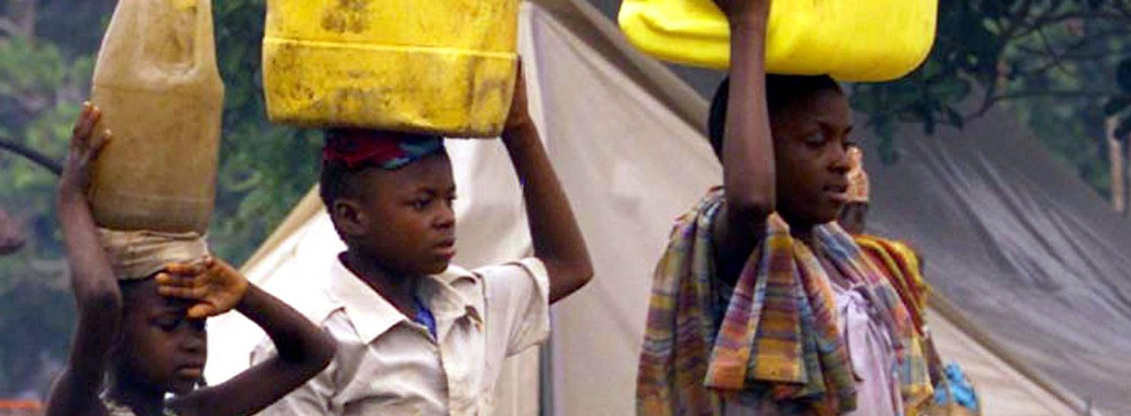 Children carrying water buckets