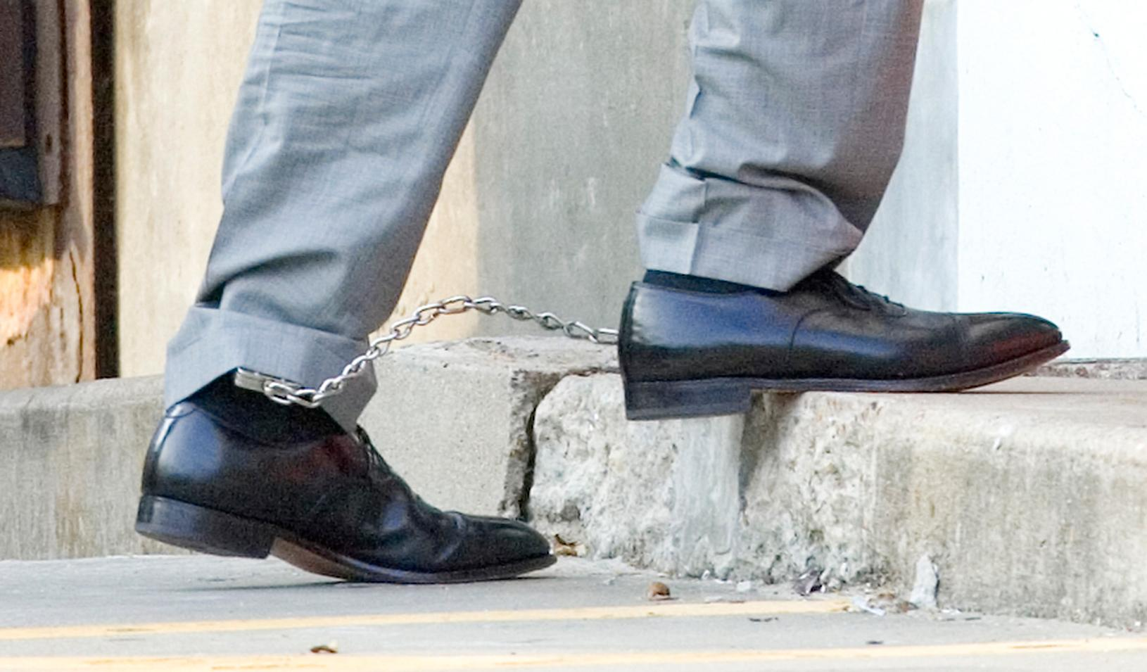 Two feet chained together