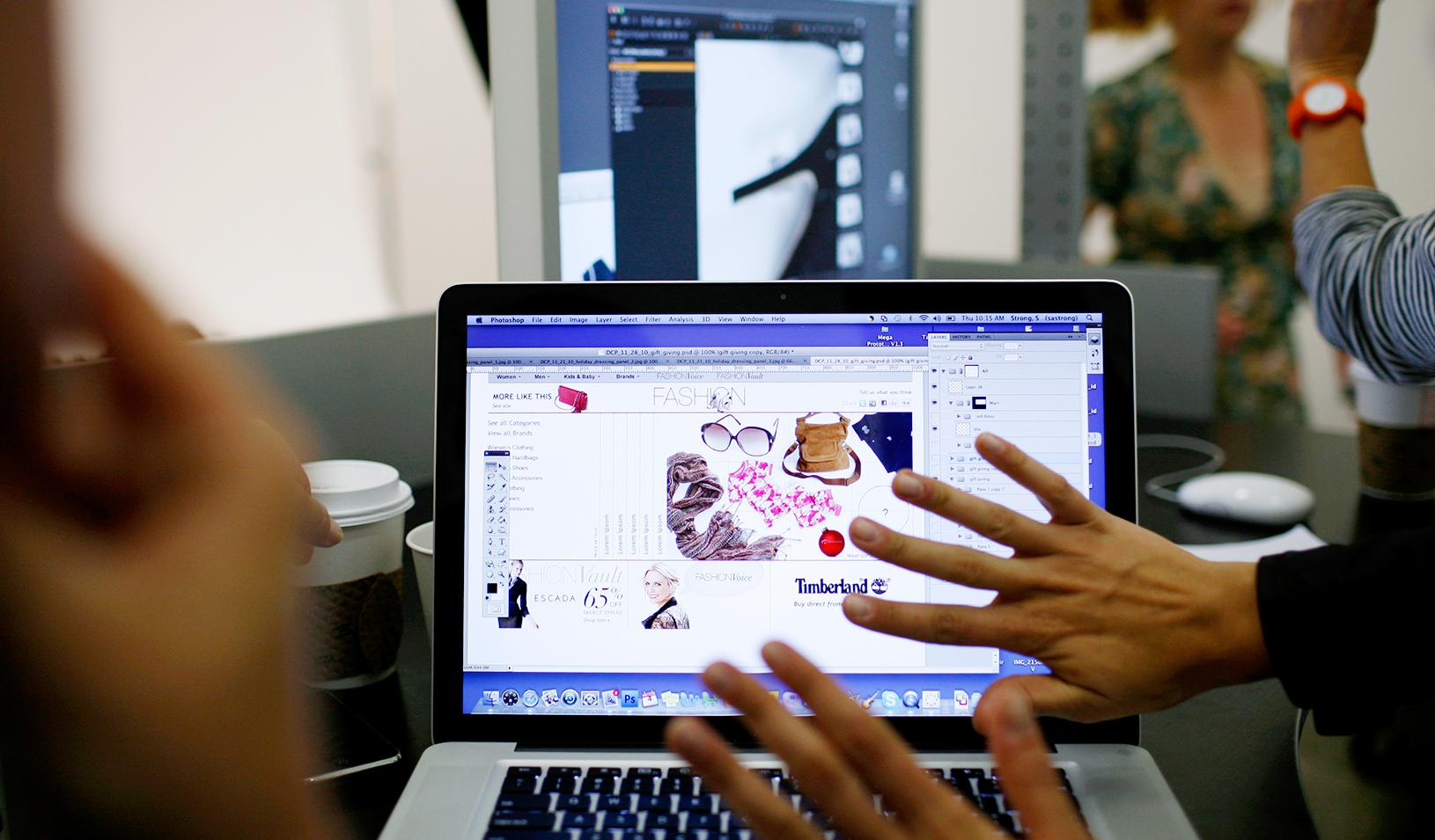 A laptop screen showing a fashion website