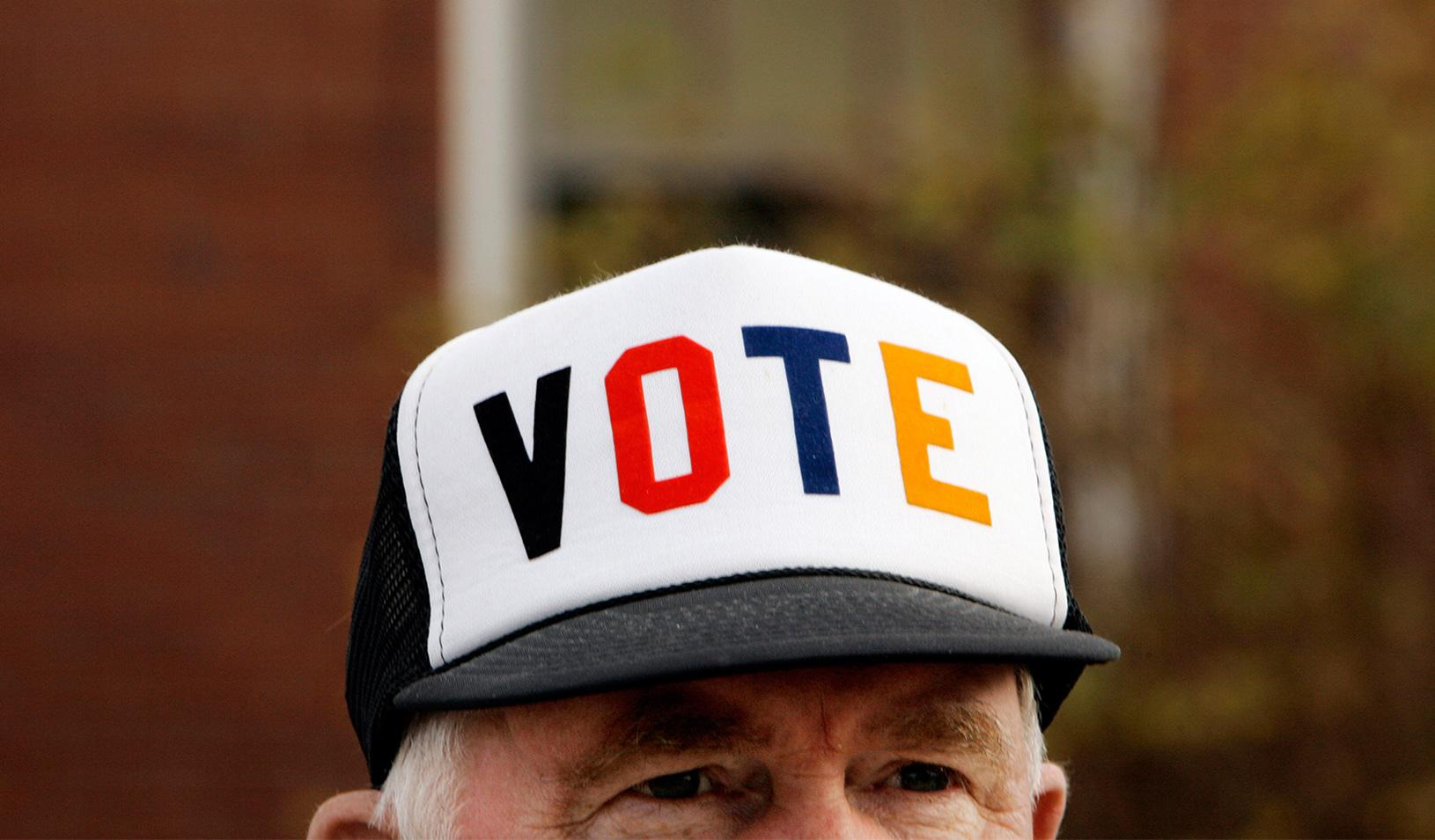 "Man with a hat that reads ""Vote"""