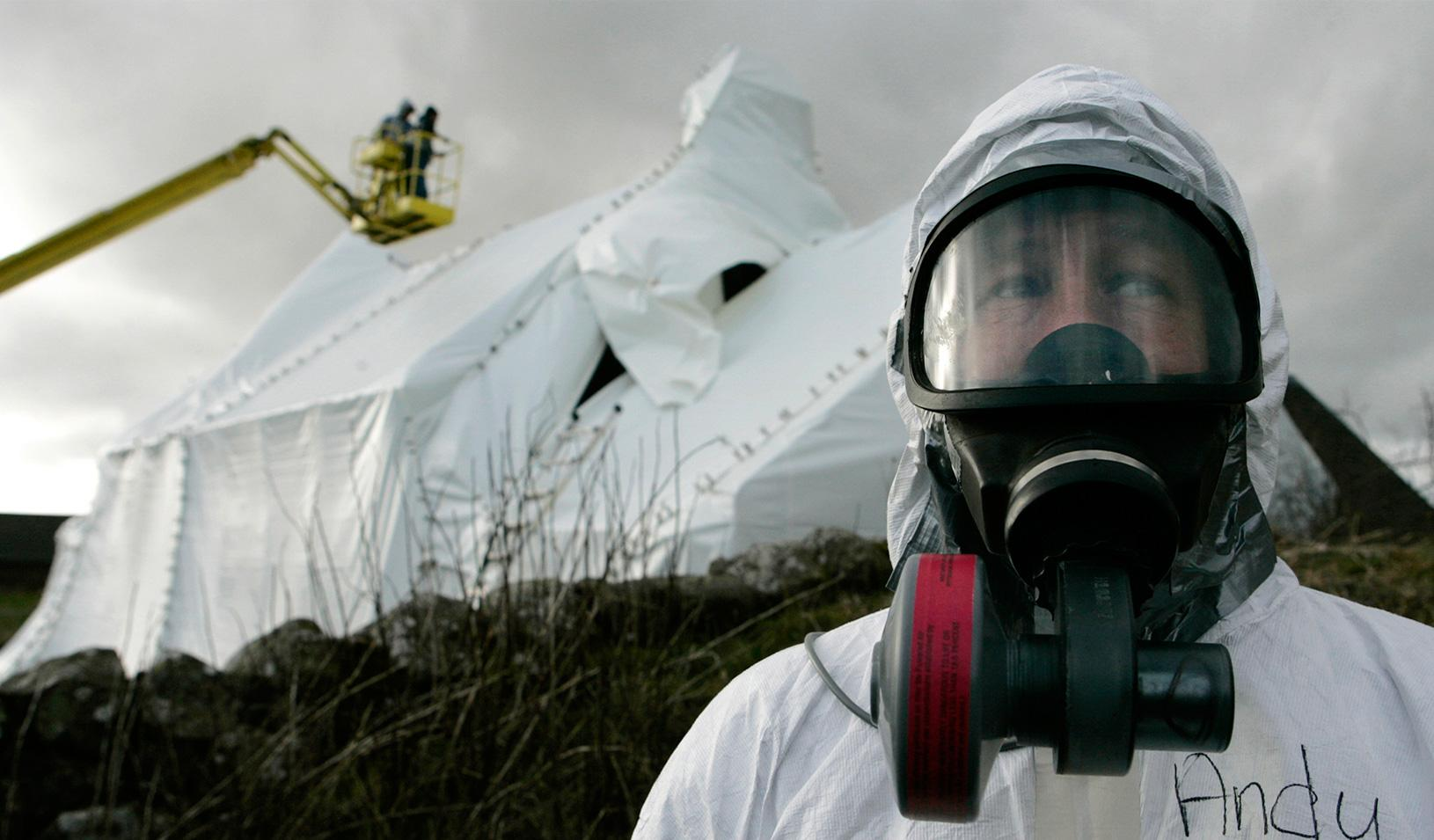 A man wearing protection in a decontamination scene