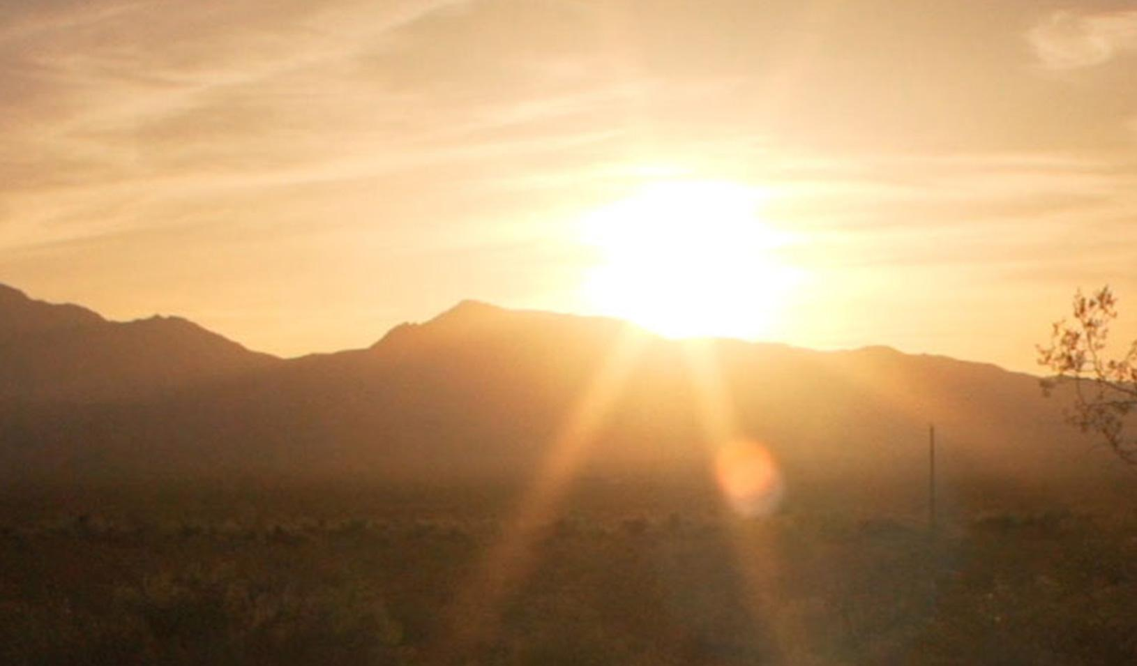 The sun rising over the mountains