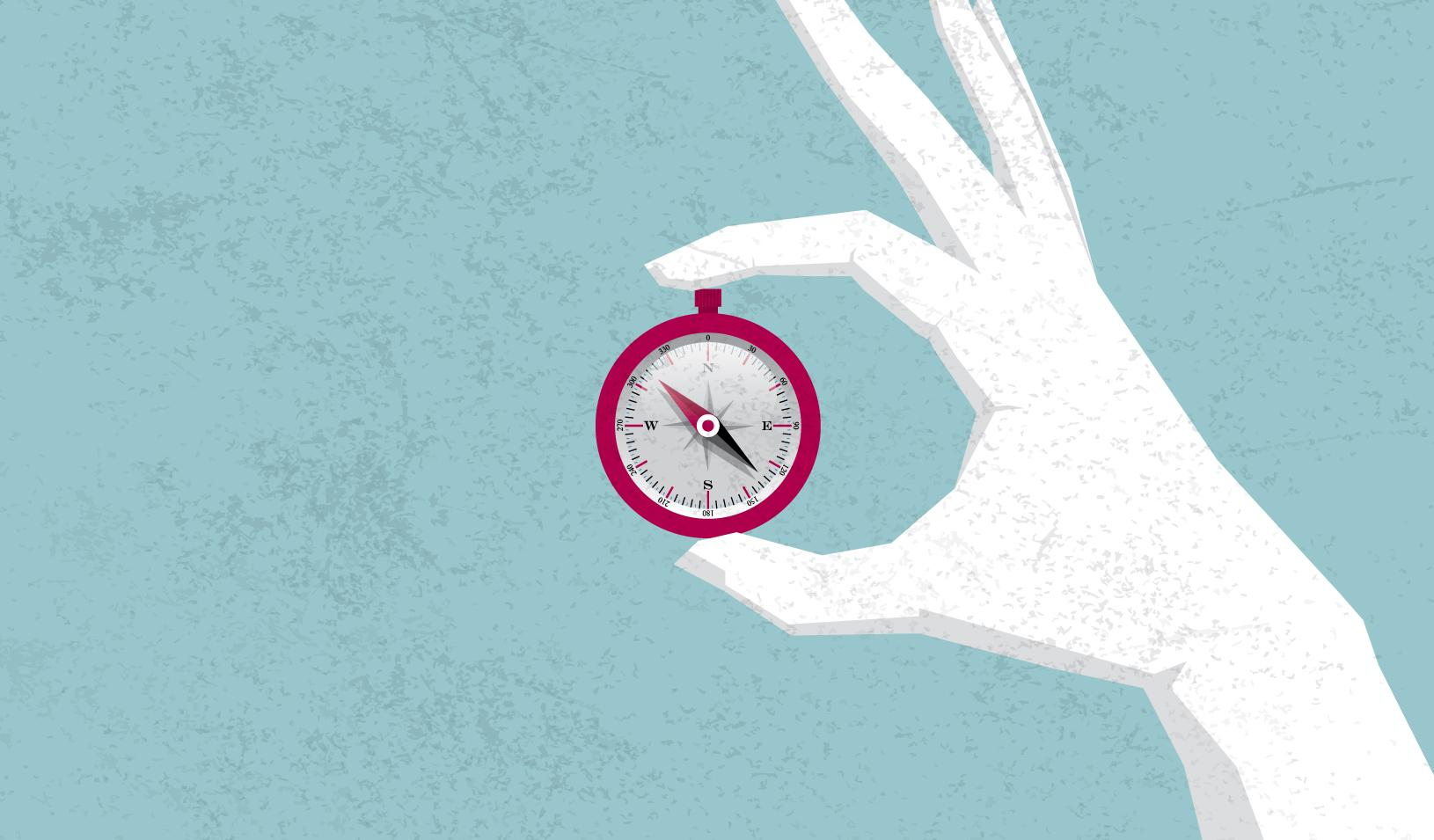 An illustration of a hand holding a compass | iStock/Hong Li