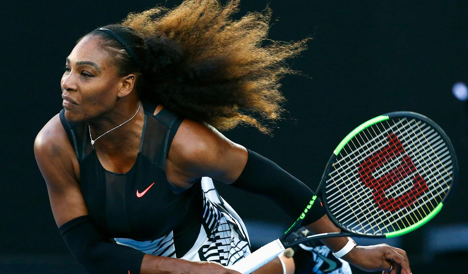 Serena Williams of the U.S. hits a shot during her Women's singles final match against Venus Williams of the U.S.