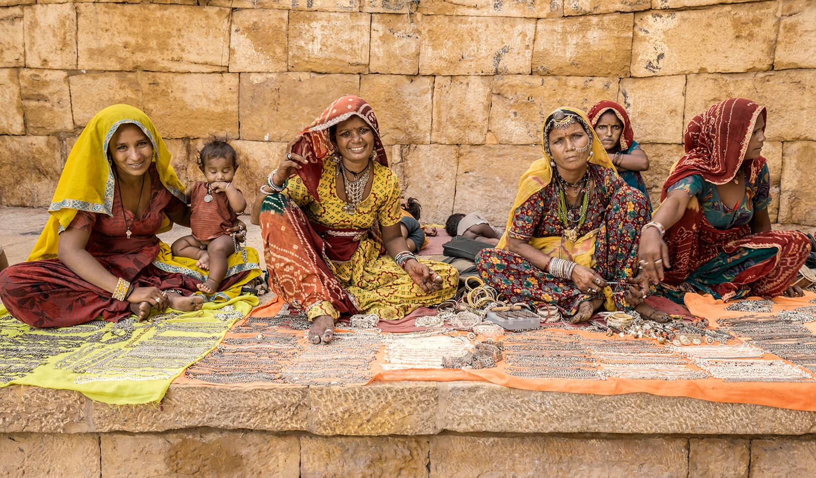 A group of women selling jewelry and handicrafts at the walls of the Jaisalmer fort in Rajasthan India. Credit: iStock/Aluxum