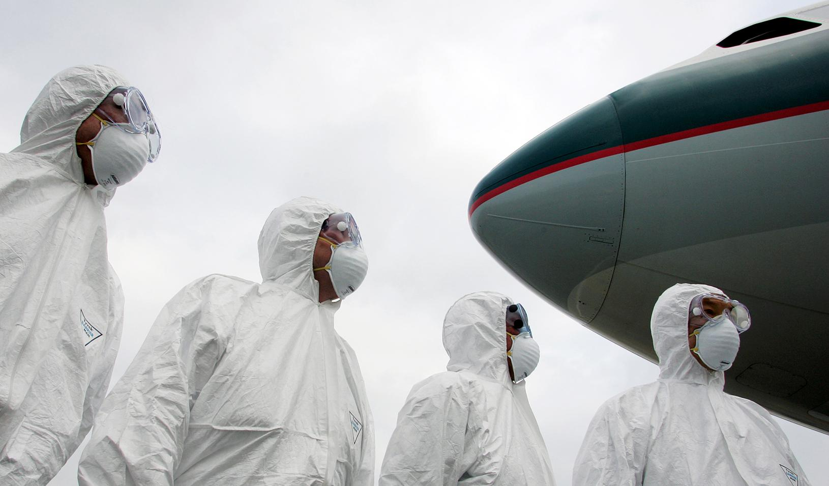 Members of Hong Kong's Health Department participate in a simulation exercise at the Hong Kong International Airport March 17, 2006