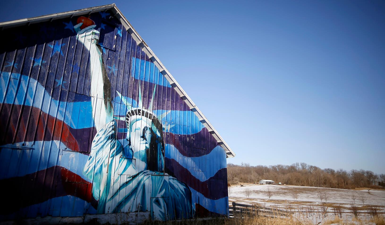 A barn is painted with an image of the Statue of Liberty and a U.S. flag in Mt. Vernon, Iowa