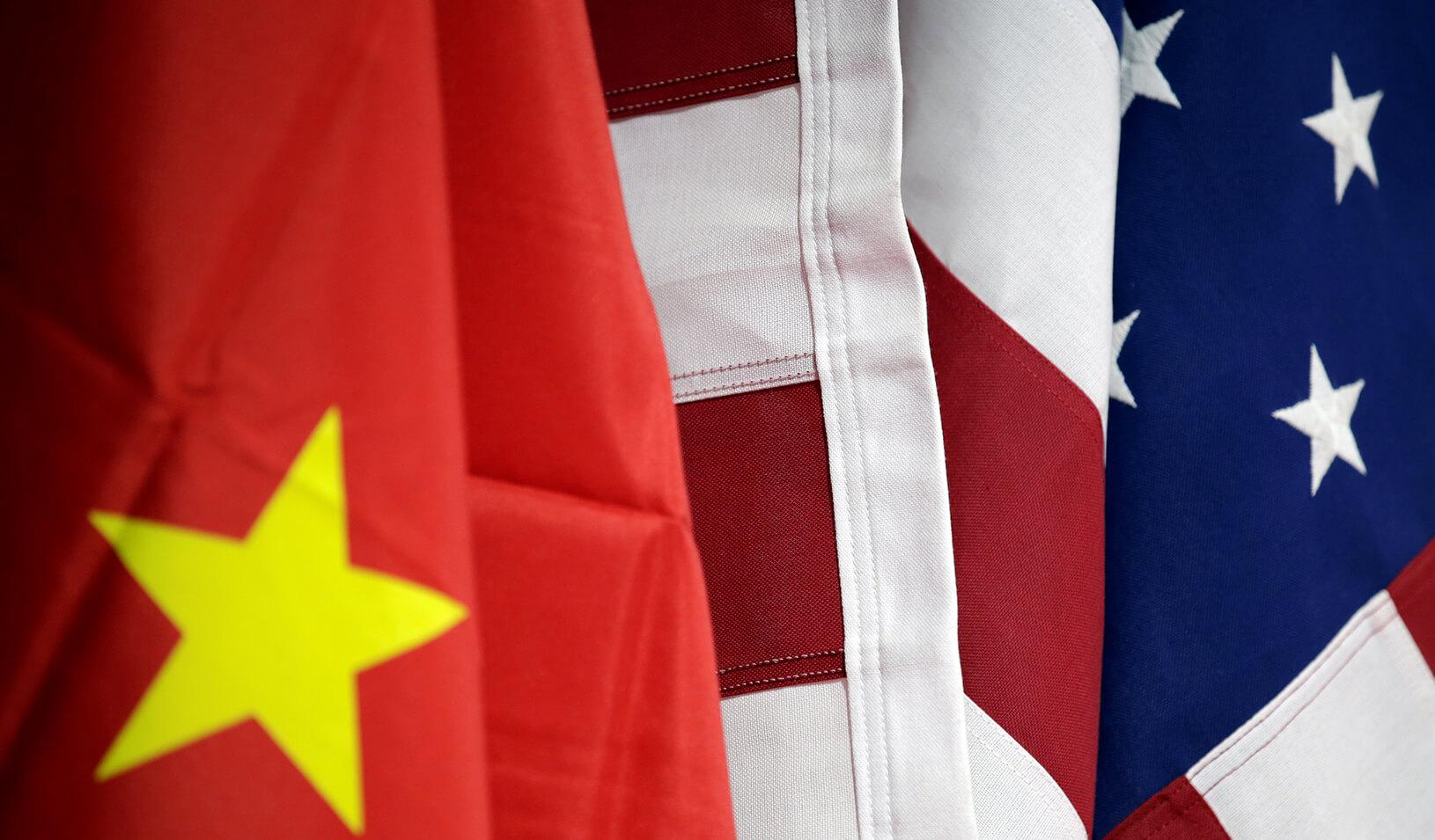 Flags of U.S. and China are displayed. Credits: Reuters/Jason Lee