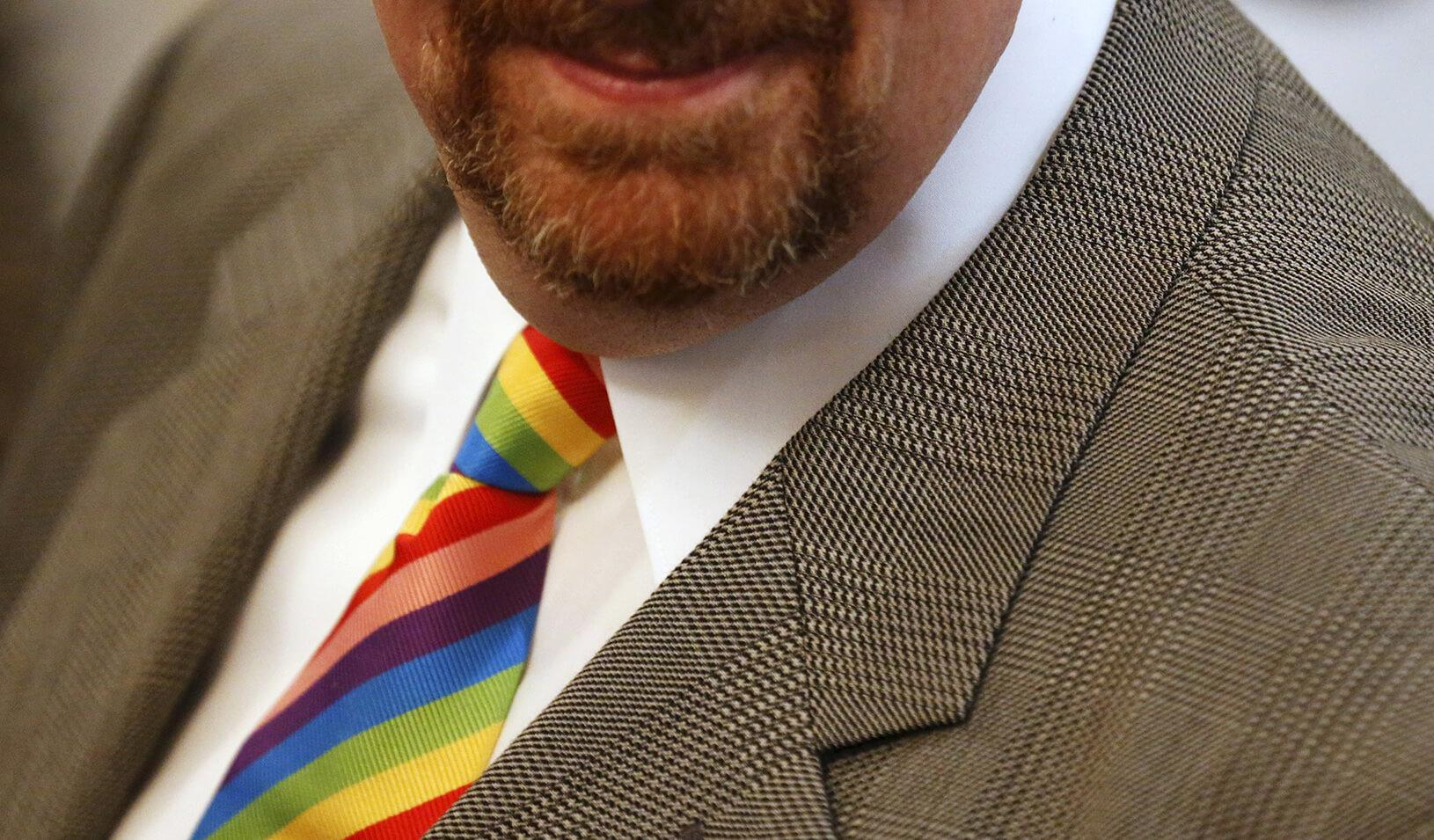 An attendee wears a rainbow tie during a reception to observe LGBT Pride Month in the East Room at the White House in Washington, June 24, 2015.