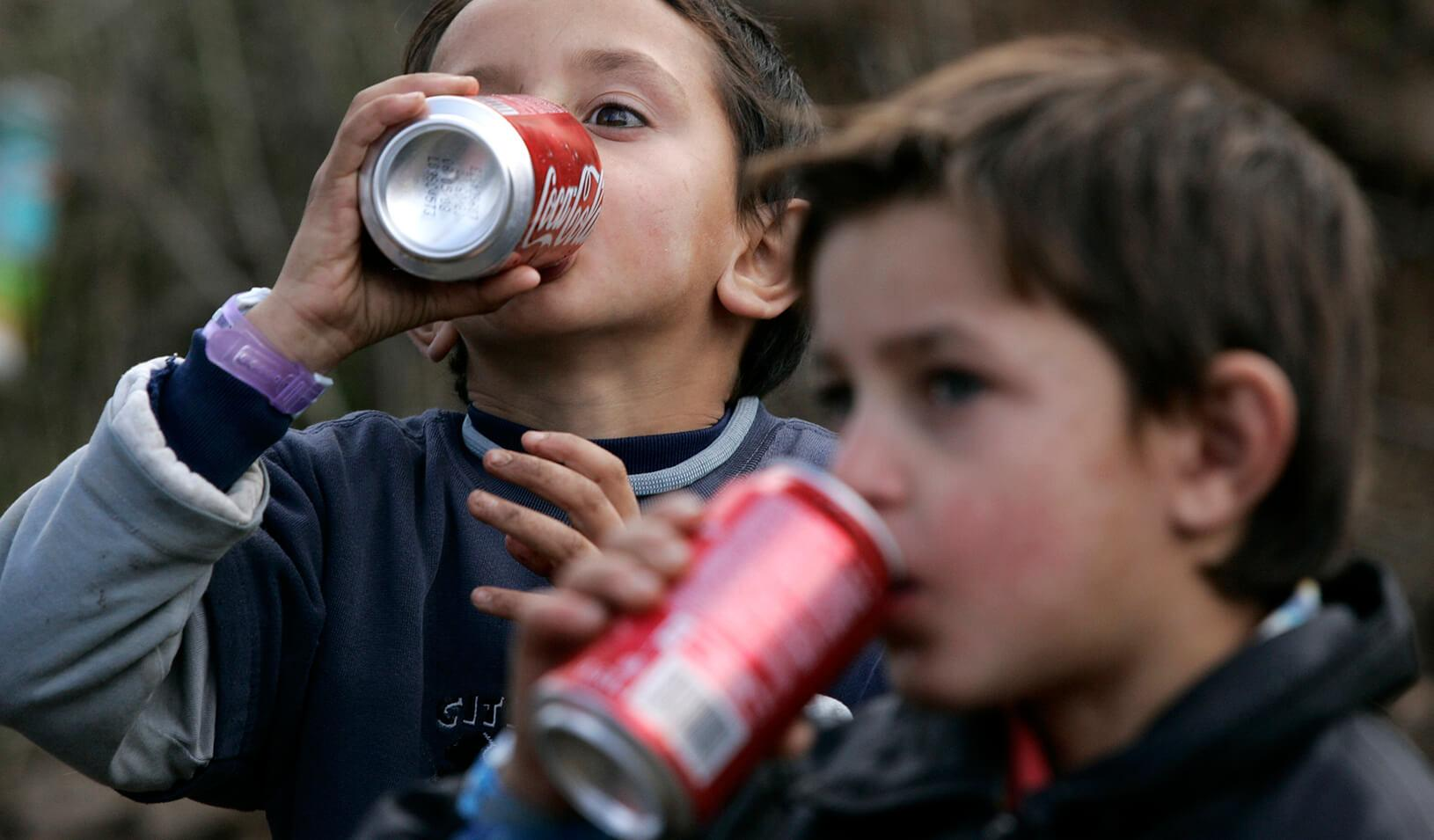 Children drinking Coca-Cola. Credit: Reuters/Hazir Reka