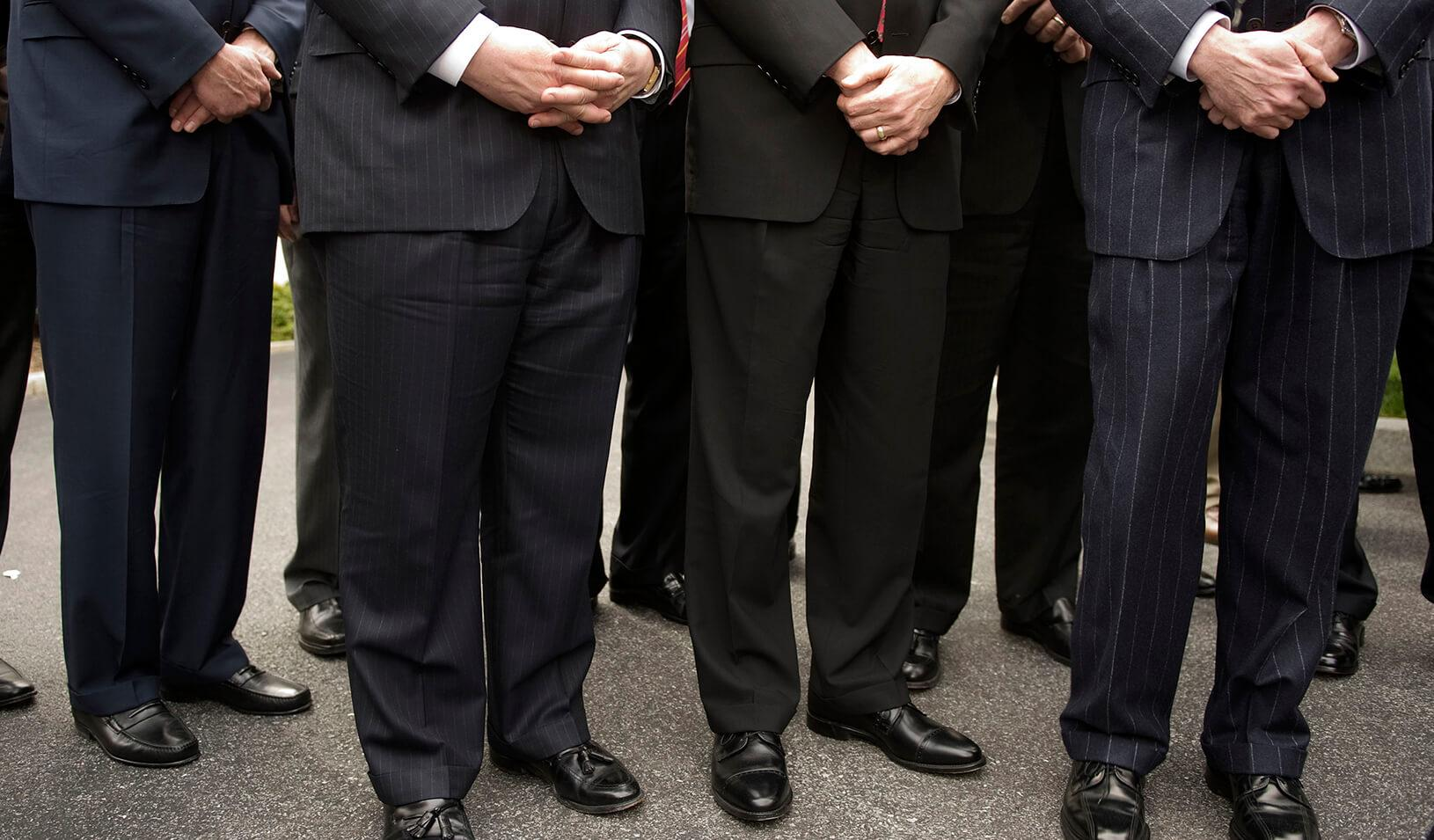 A group of men in pinstripe suits