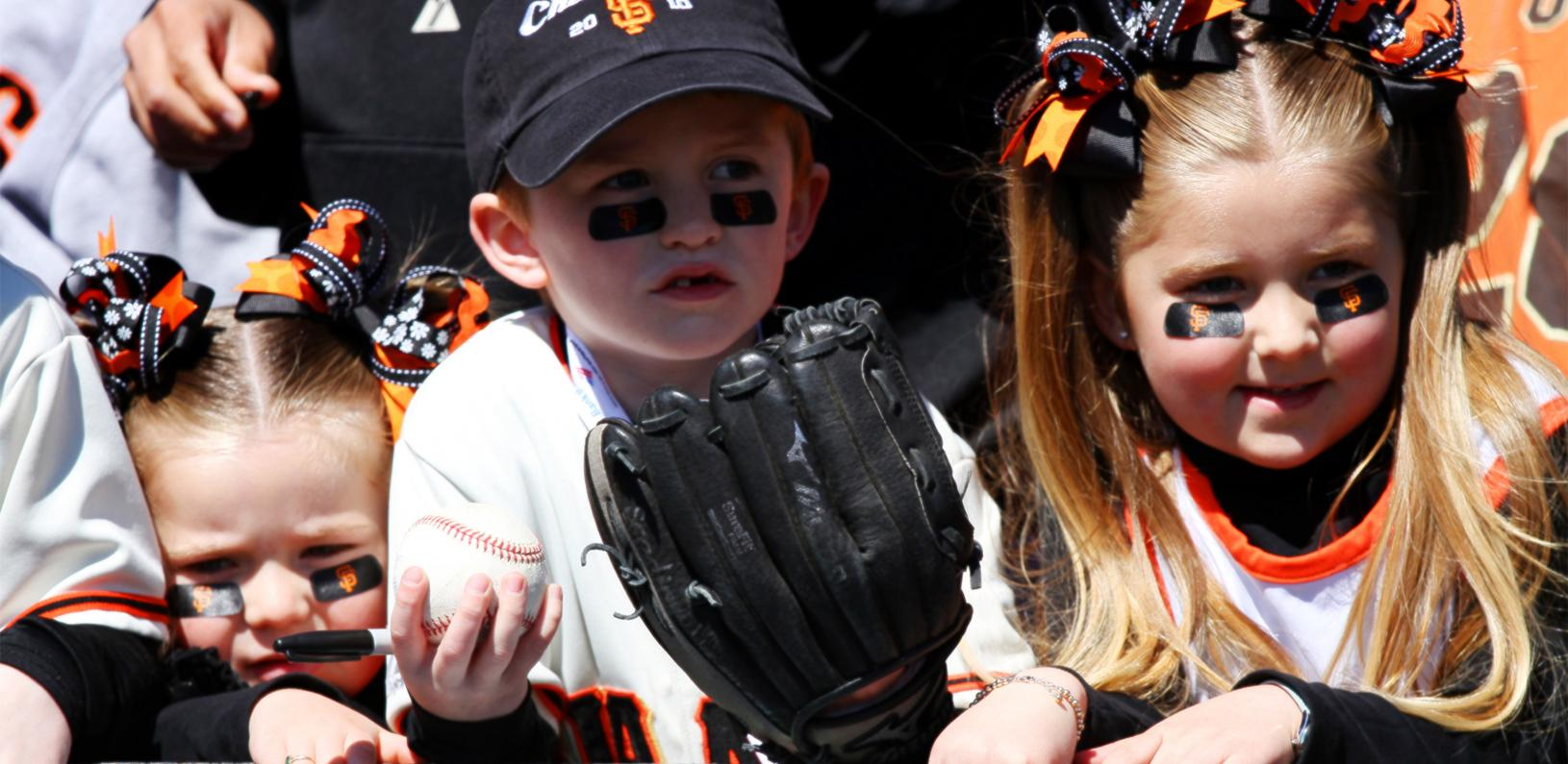 Three children decked out in San Francisco Giants gear
