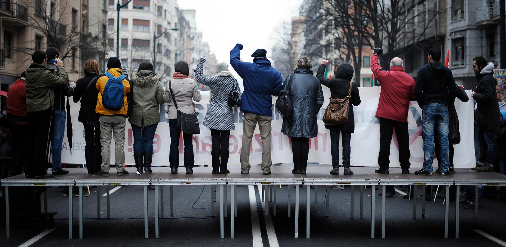 Protestors on a platform in the middle of a street