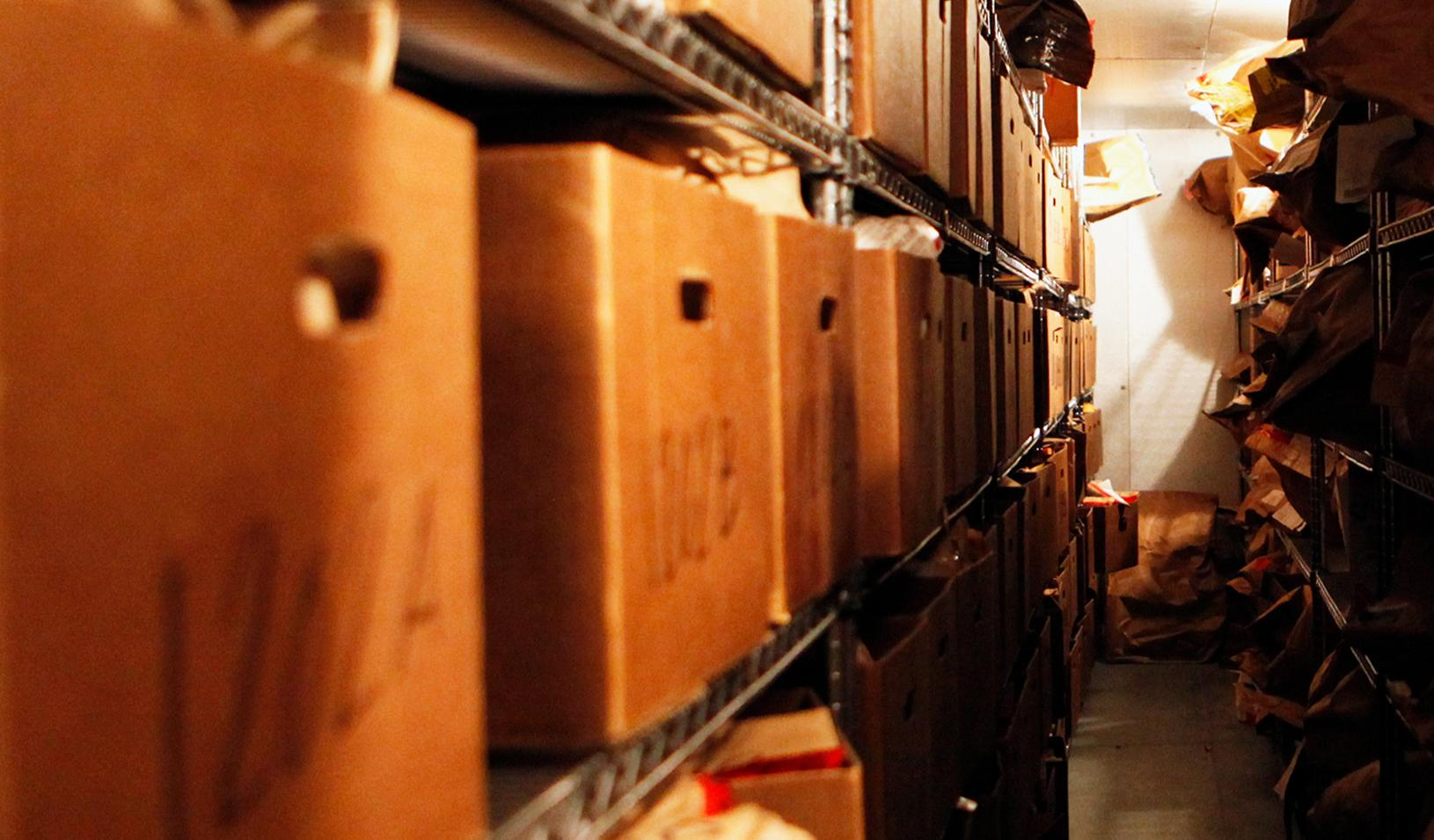 Forensic lab storage room shelves overflowing with untested rape kits | Photo courtesy of Joyful Heart Foundation