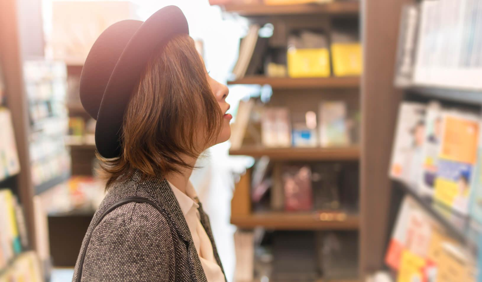 A woman browsing the shelves at a bookstore. Credit: iStock/Satoshi-K