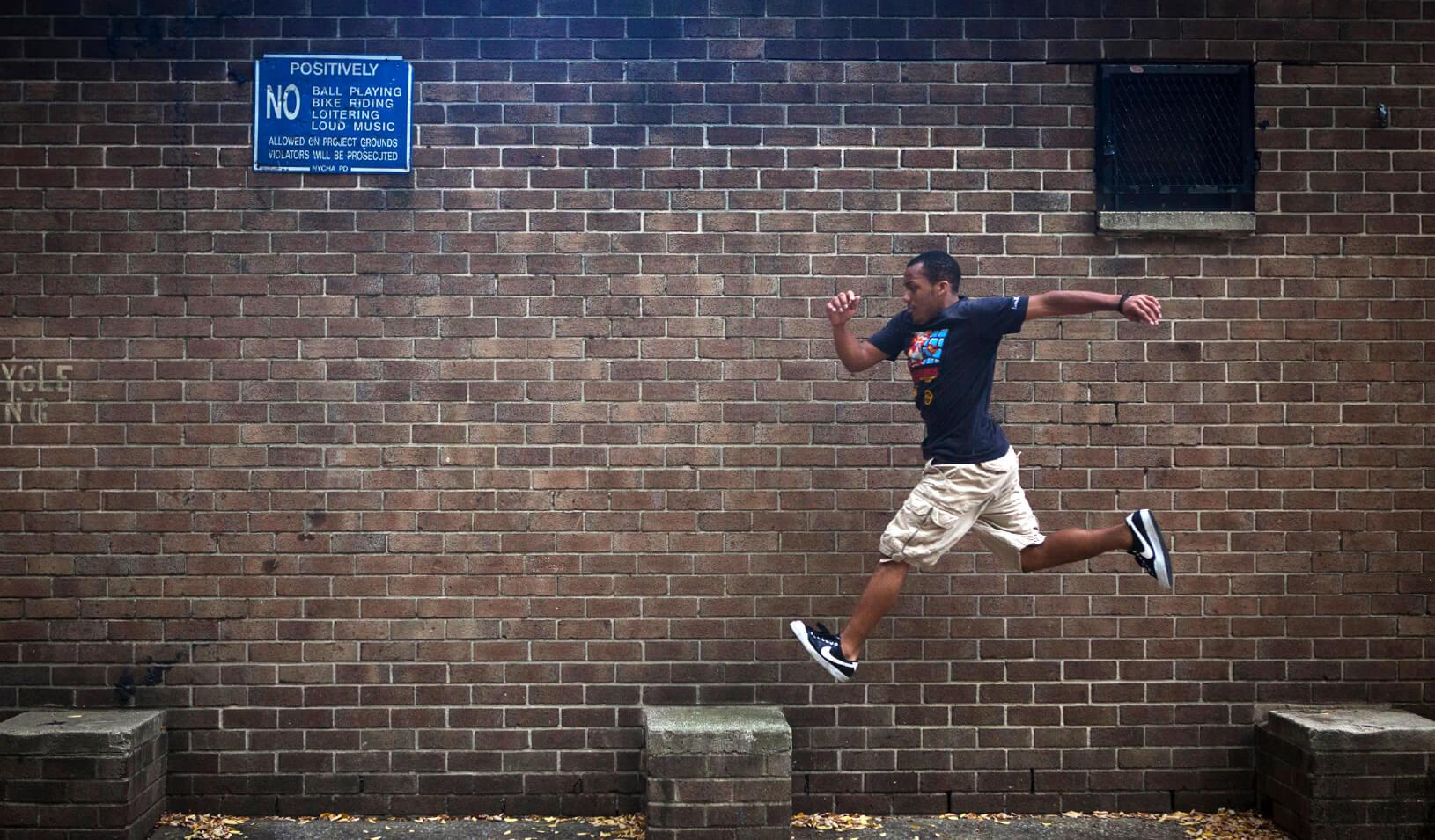 Rashaad Gomez practices parkour in a park in New York. Credit: Reuters/Carlo Allegri