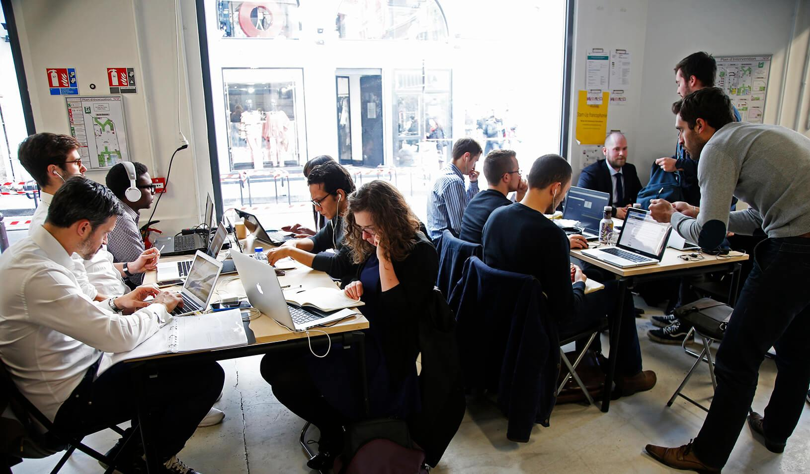 "Entrepreneurs work at their computer laptops at the so-called ""incubator"" of French high-tech start-ups ""Numa"" in Paris, France."