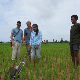 A team of Entrepreneurial Design for Extreme Affordabiilty field tests the RiceRunner, a fertilizer applicator, in Cambodia
