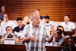 A professor teaching students