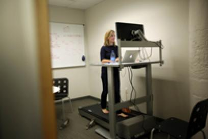 Woman working at a treadmill desk