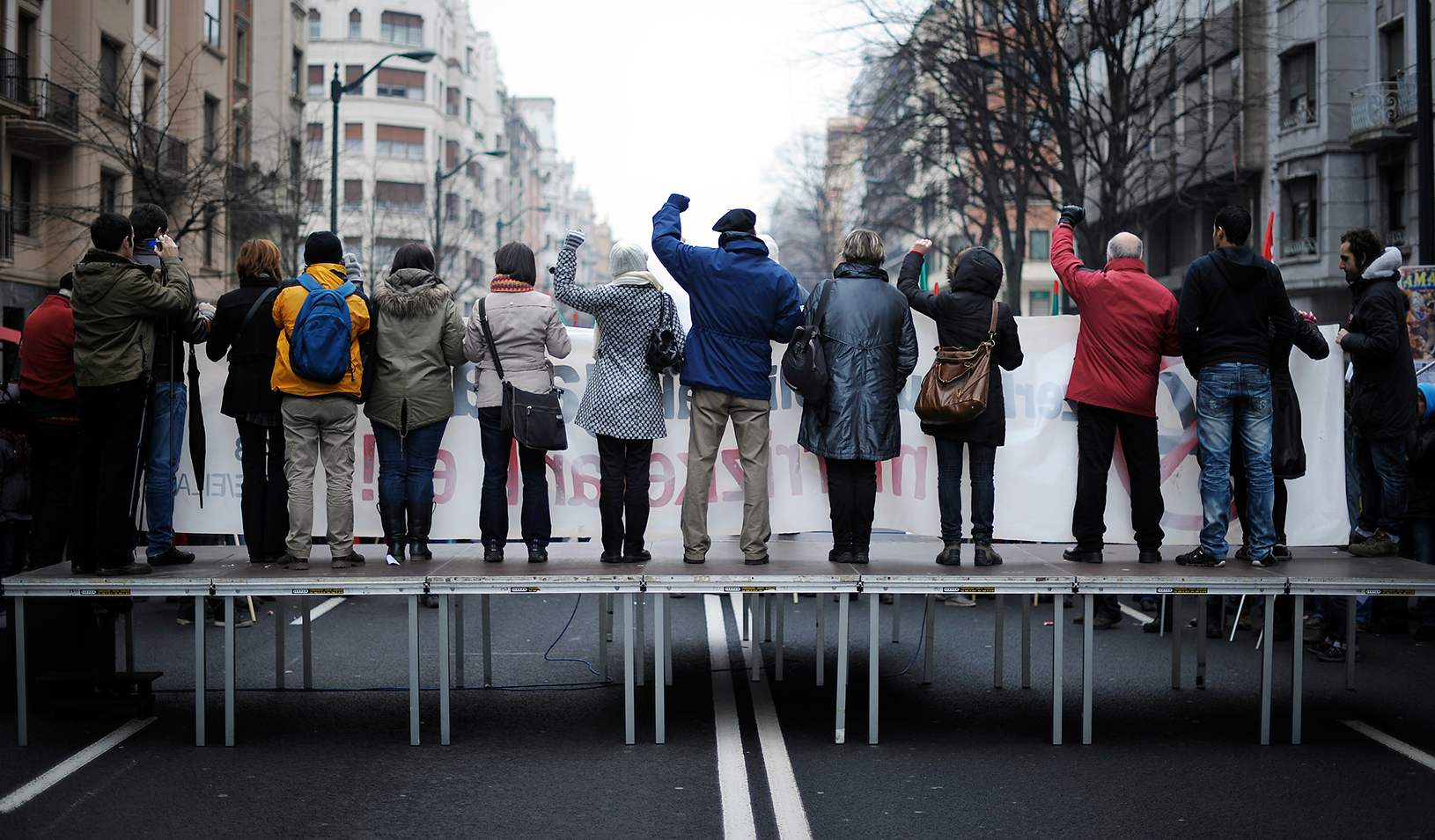 Protestors on a platform in the middle of a street | Reuters/Vincent West
