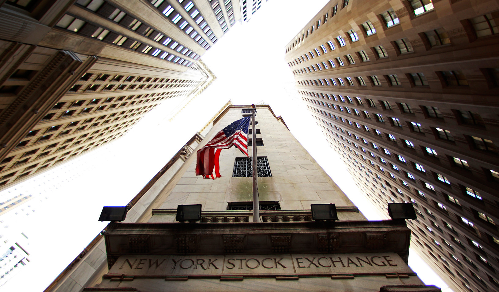 A flag flies on outside of the New York Stock Exchange building in New York.