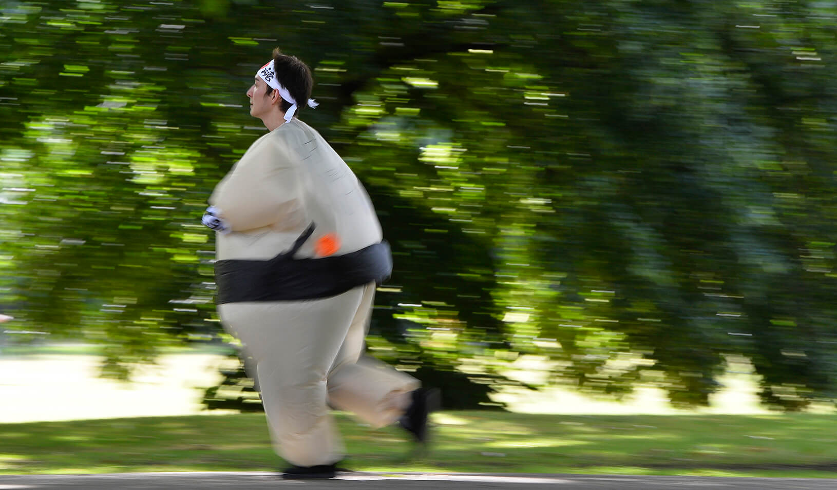 A runner dressed in an inflatable Sumo costume takes part in a 5k. | Reuters/Toby Melville