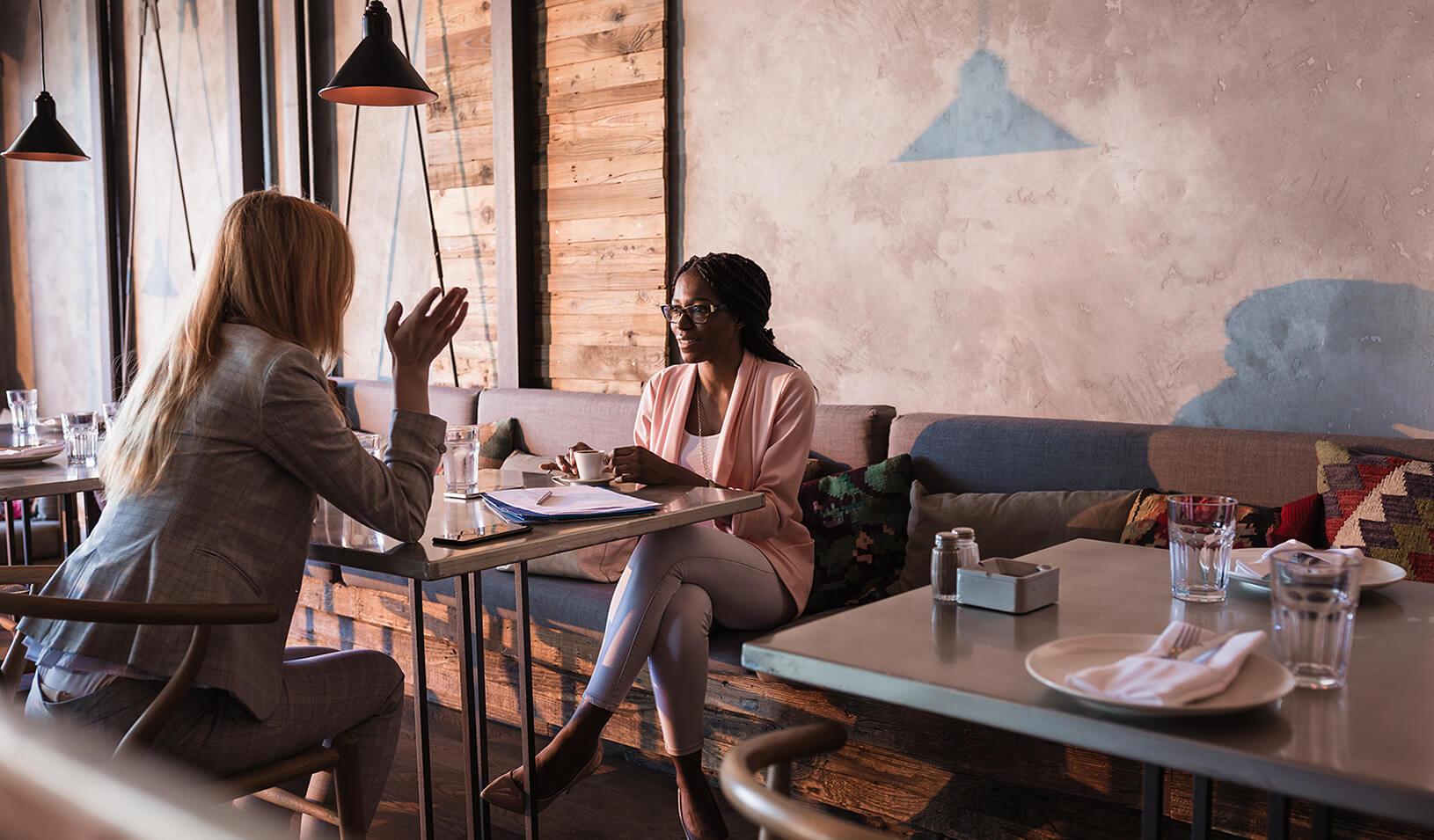 Two businesswomen having coffee. Credit: iStock/NoSystem images